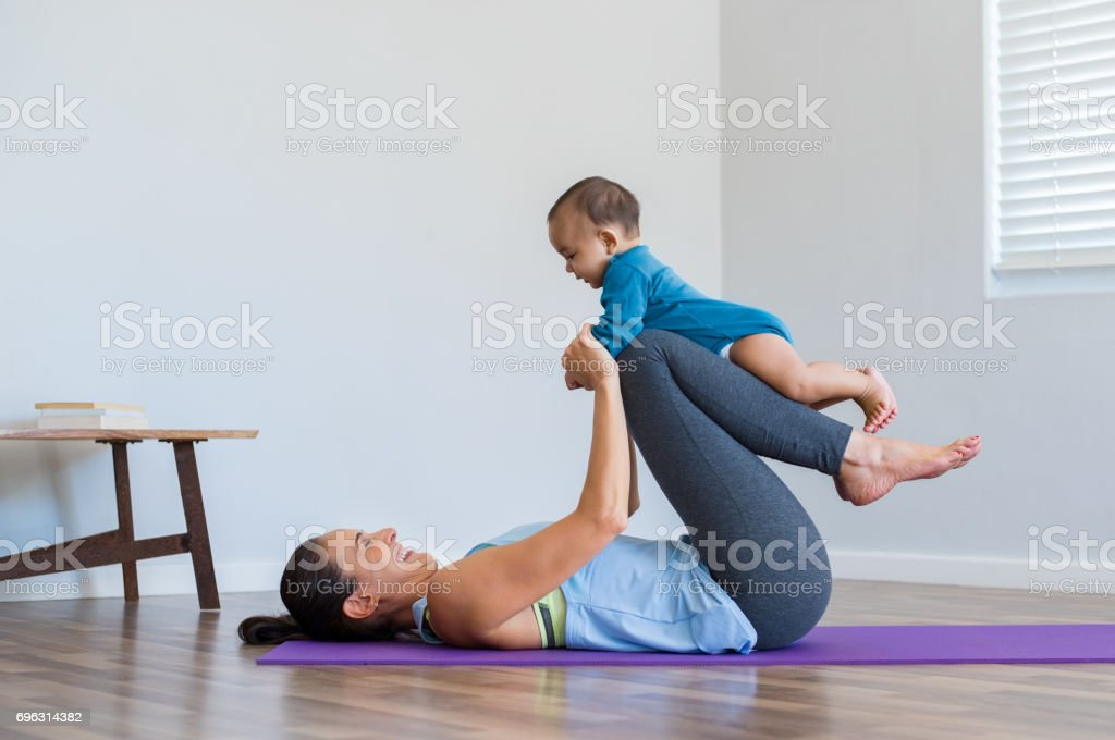 Mother and little son exercising stock photo