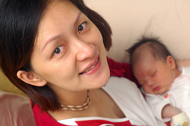 mother and newborn baby stock photo