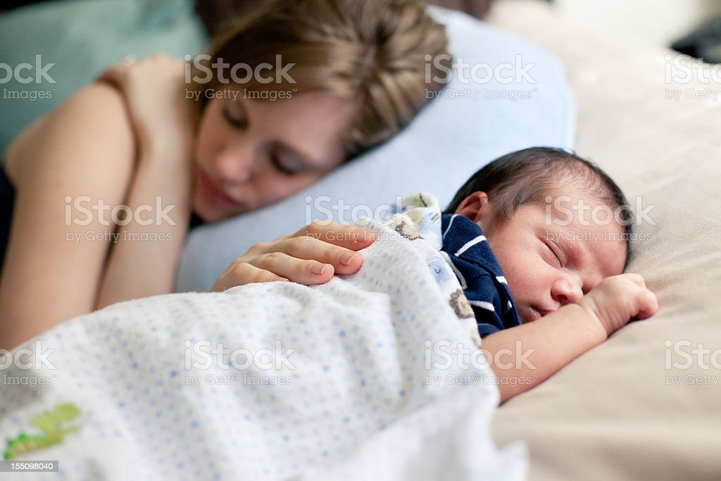 Mother and Newborn Sleeping Peacefully on Bed Together - Royalty-free 0-1 Months Stock Photo