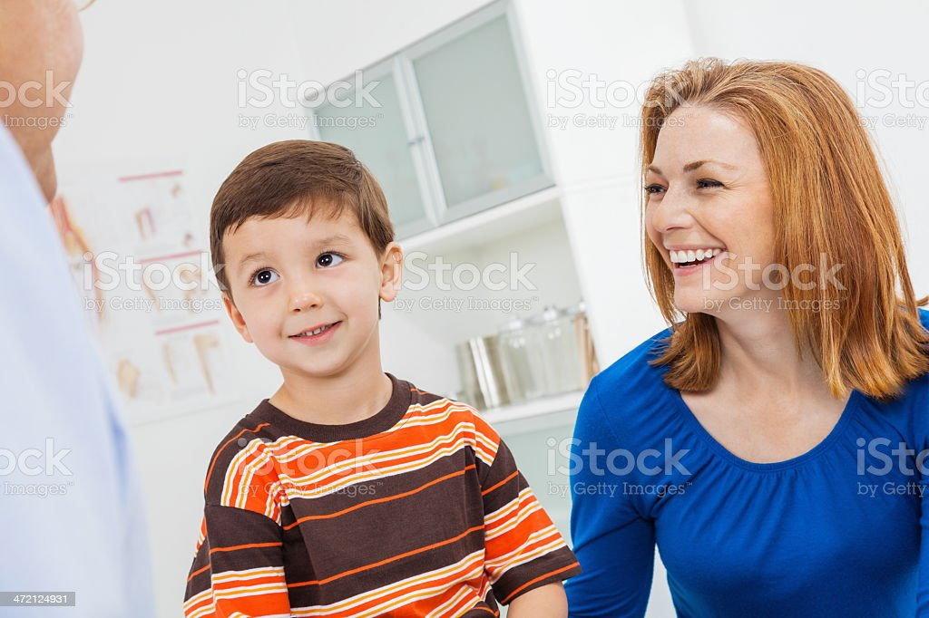 Mother and preschool age son with pediatrician in doctor\'s office