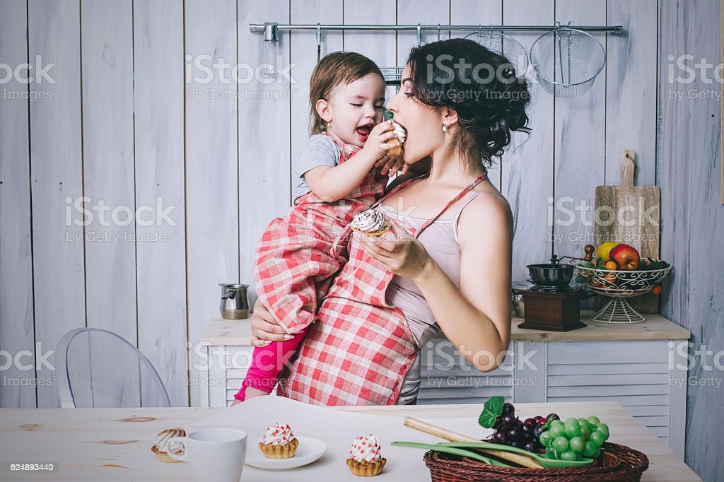 Mother and small child in the kitchen at home beautiful stock photo