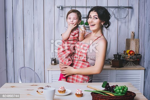 istock Mother and small child in the kitchen at home beautiful 624893744