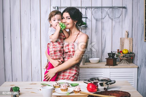 istock Mother and small child in the kitchen at home beautiful 624893980