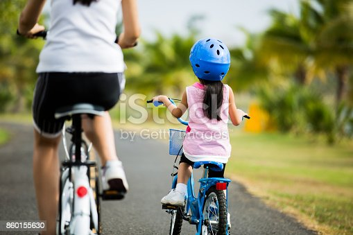 istock Mother and son are cycling in the park. 860155630