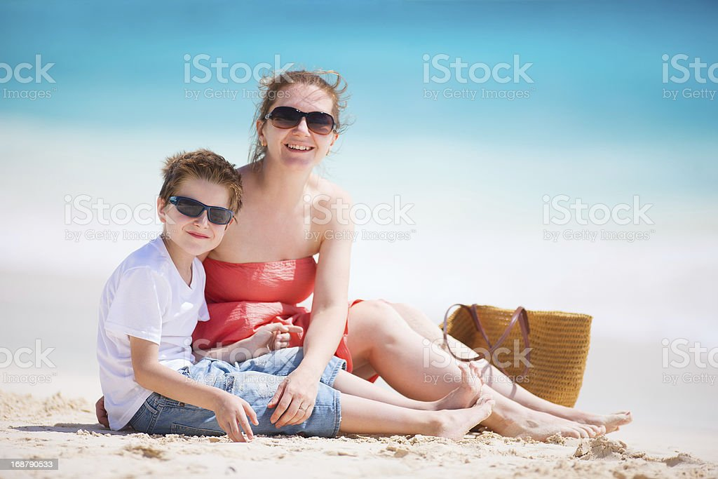 Mother and son at beach royalty-free stock photo