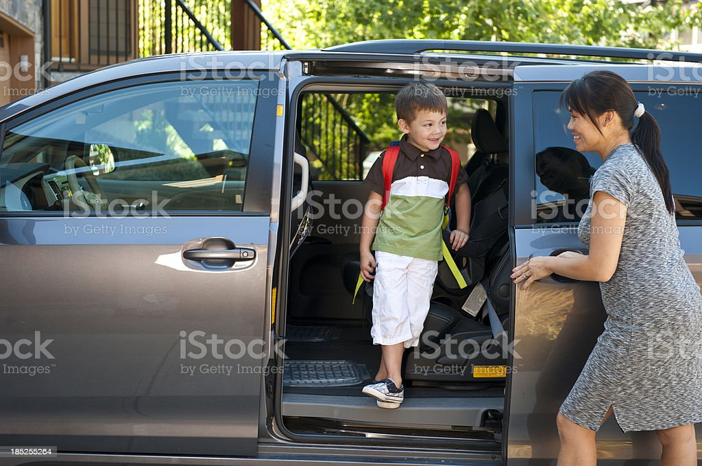 Mother and Son at Minivan royalty-free stock photo