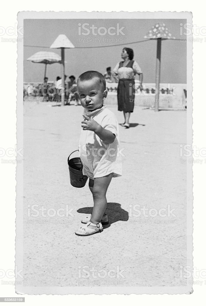 Mother and son at the beach in 1950 stock photo