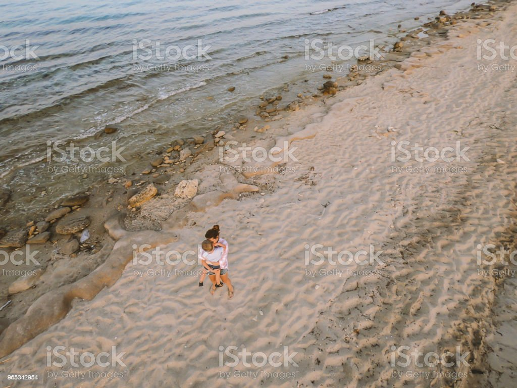 Mother and son at the beach royalty-free stock photo