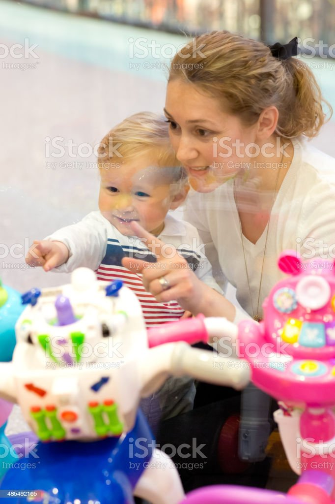 Mother and son at toy store display stock photo