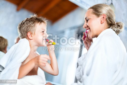 istock Mother and son brushing teeth together 171359993