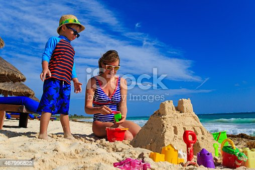 512726470 istock photo mother and son building sand castle on tropical beach 467996822