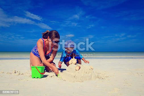 512726470 istock photo mother and son building sand castle on tropical beach 533628123