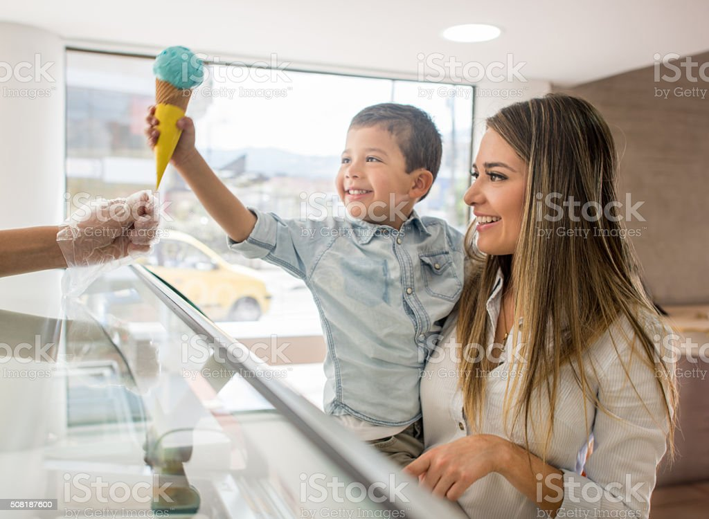 Mother and son buying an ice cream stock photo