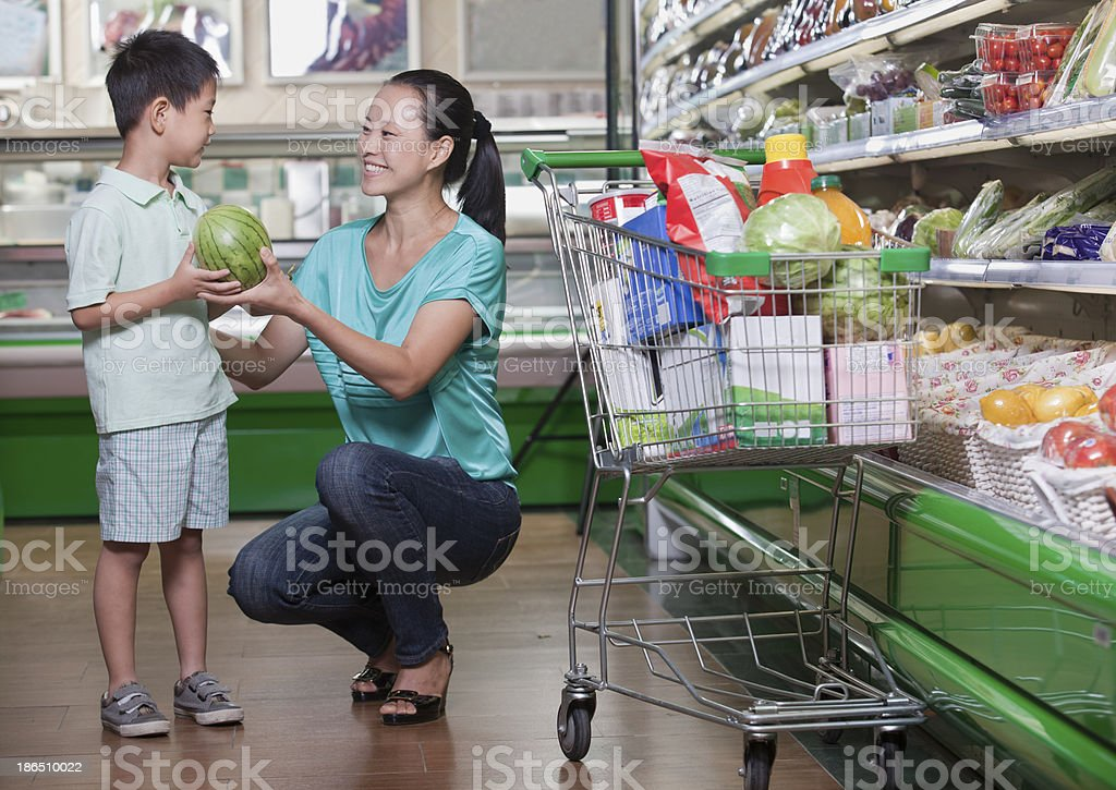 Mother and son buying watermelon in supermarket, Beijing royalty-free stock photo