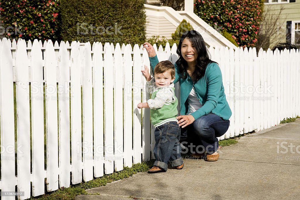 Mother and Son by Picket Fence royalty-free stock photo