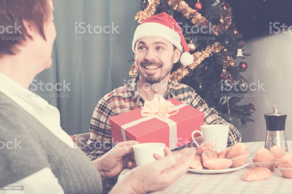 Mother and son Christmas gifts - Royalty-free Adult Stock Photo