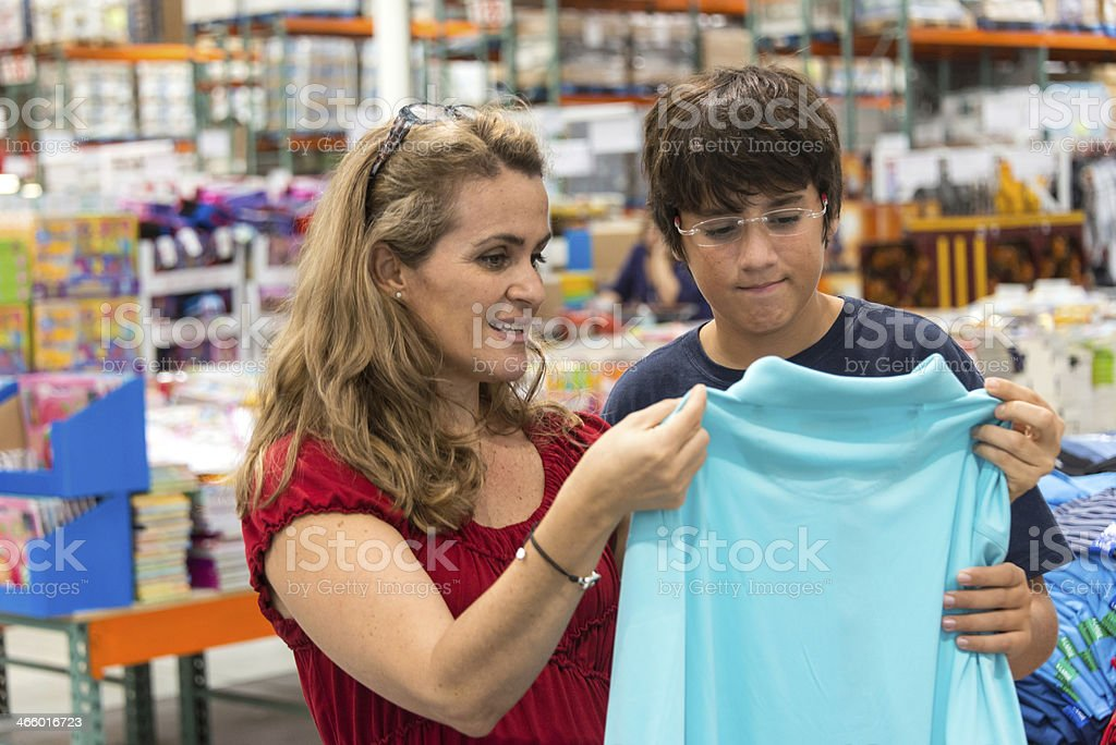 mother and son clothes shopping stock photo