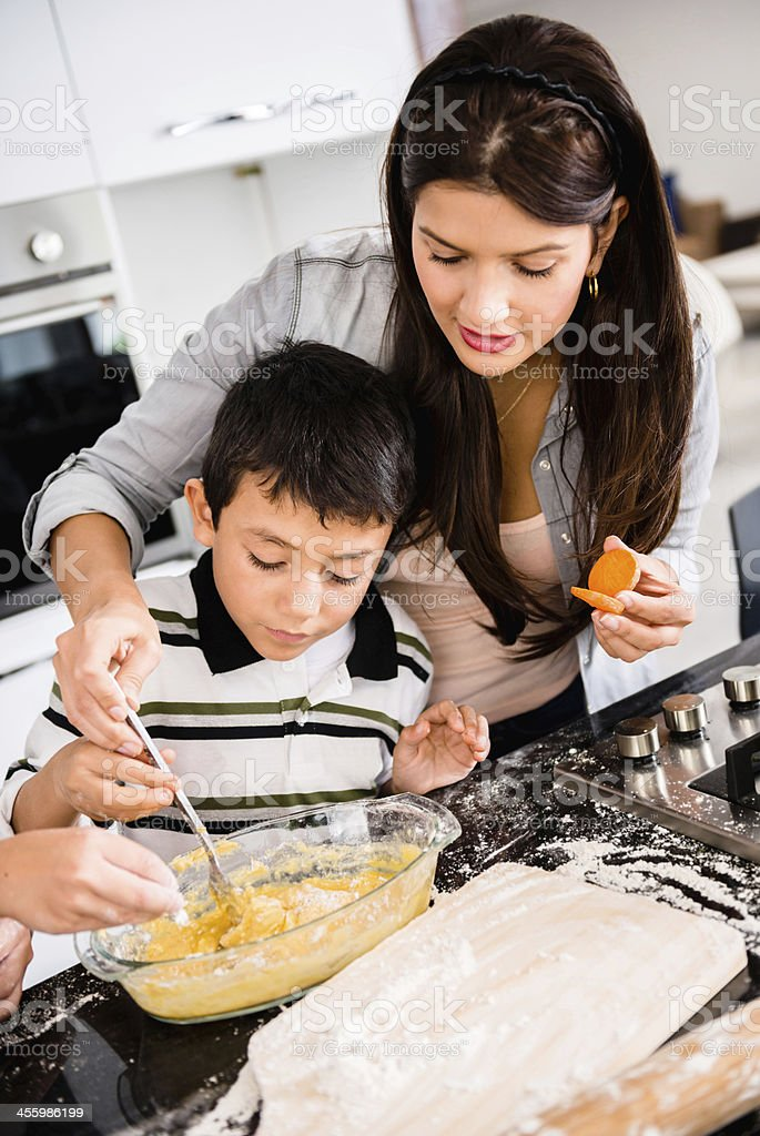 Mother and son cooking dinner stock photo