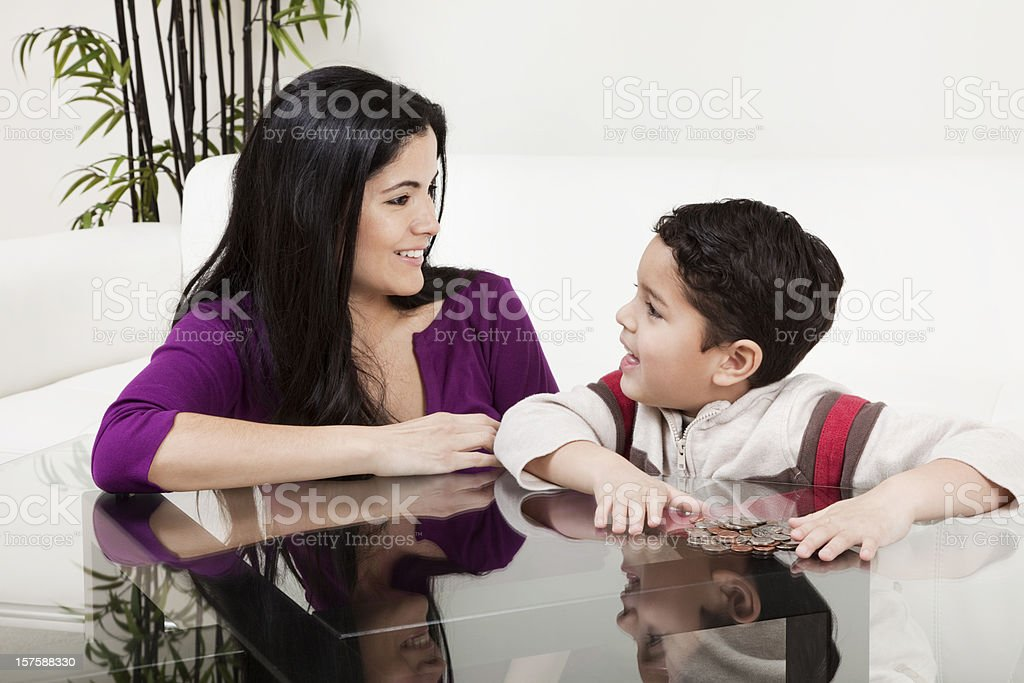 Mother and Son Counting Change royalty-free stock photo