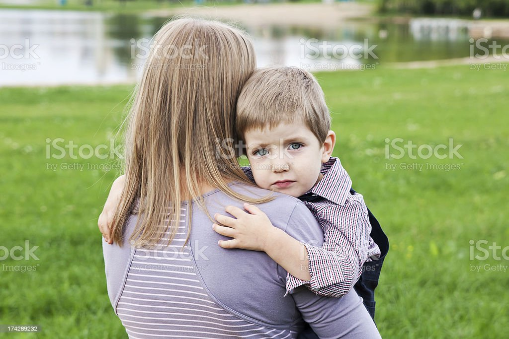Mother and son cuddling royalty-free stock photo