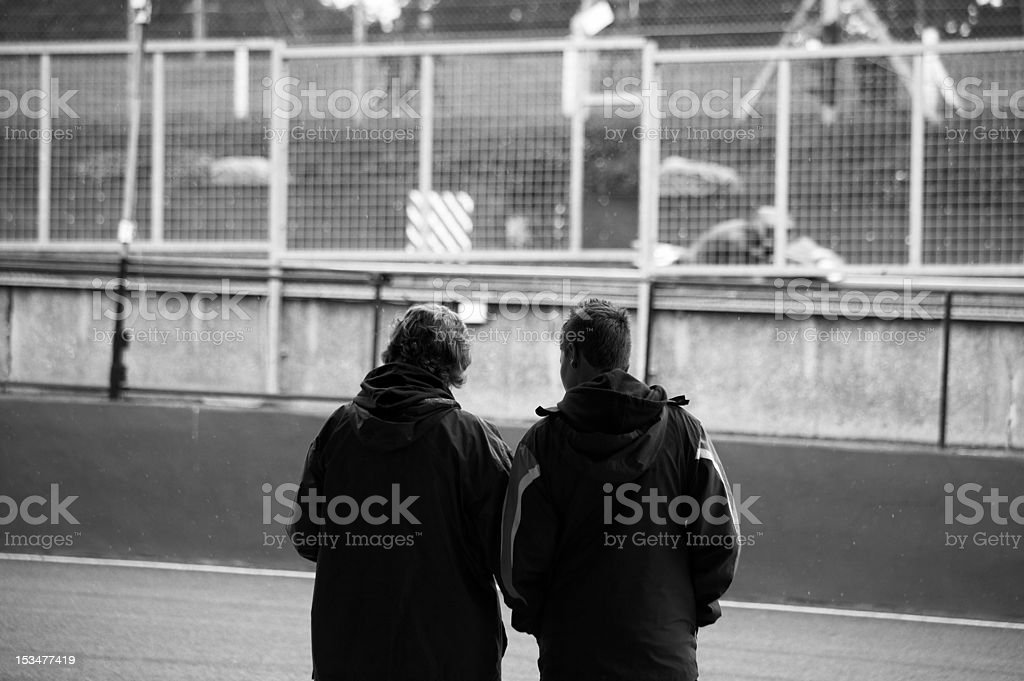 Mother and son discussing the race. stock photo