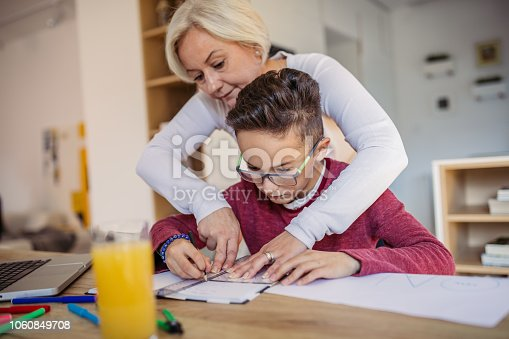680535874 istock photo Mother and son doing homework 1060849708