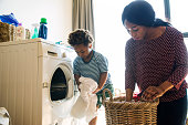 Mother and son doing housework together