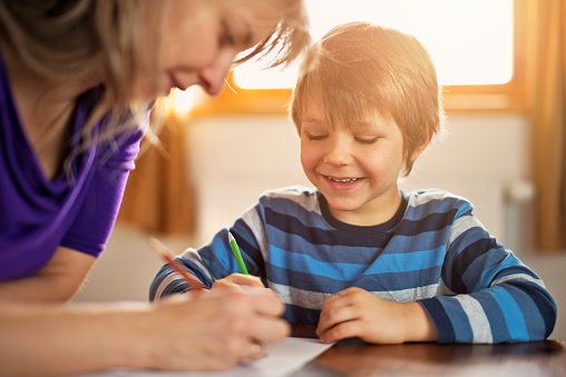 istock Mother and son drawing together 467587788