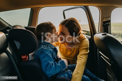 829619540 istock photo Mother and son driving in a car 1143494342