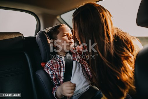 829619540 istock photo Mother and son driving in a car 1143494407