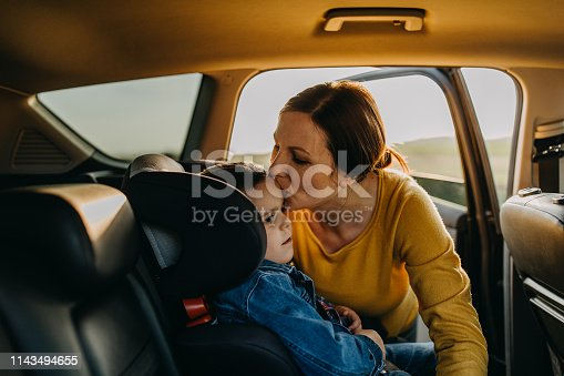 istock Mother and son driving in a car 1143494655