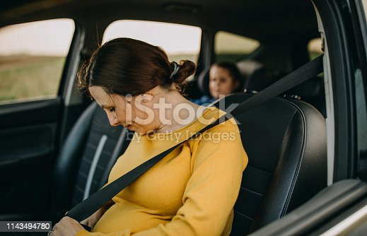 istock Mother and son driving in a car 1143494780