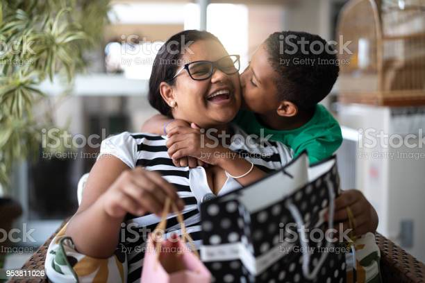 Mother And Son Embracing And Receiving Gifts Mothers Or Childrens Day Stock Photo - Download Image Now