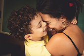 istock Mother and son embracing with love. 959720640