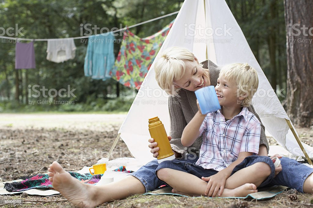 Mother and son enjoying campsite royalty-free stock photo