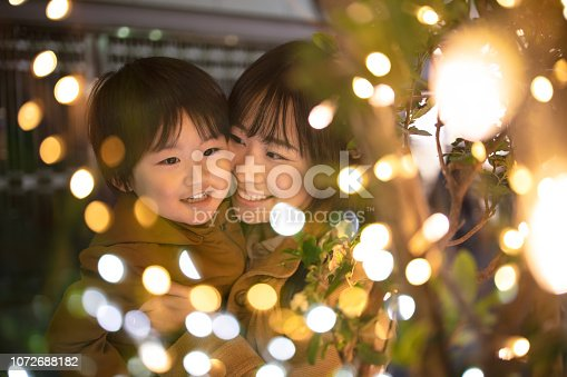 Mother and son enjoying Christmas lights