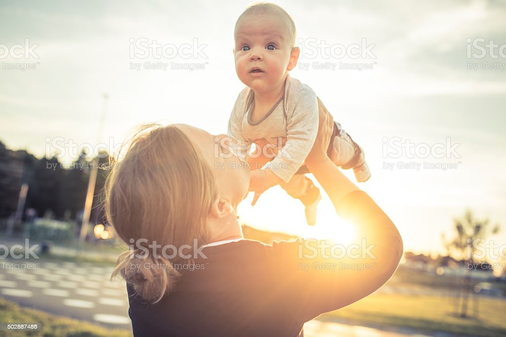 Mother and son enjoying outdoors stock photo