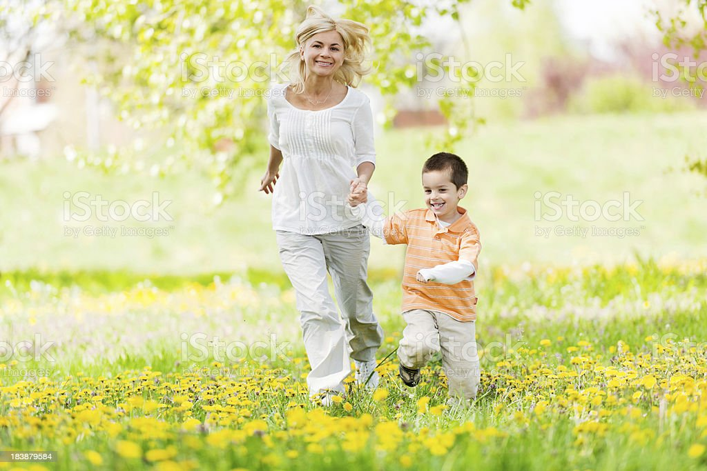 Mother and son enjoying themselves in the park royalty-free stock photo