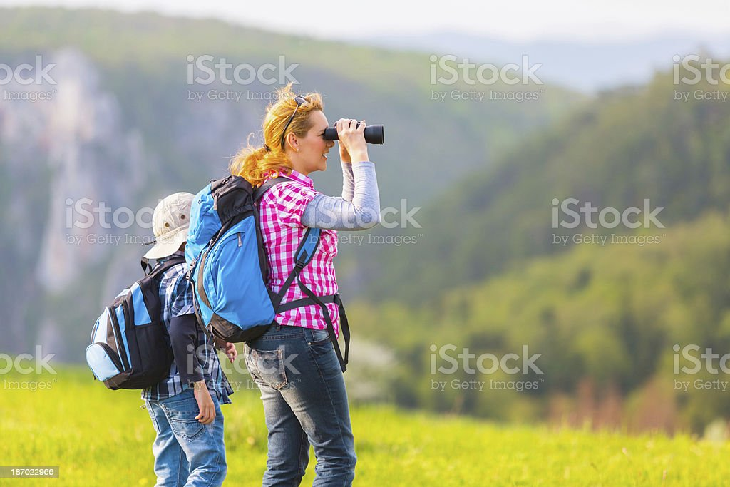 Mother and son exploring nature royalty-free stock photo