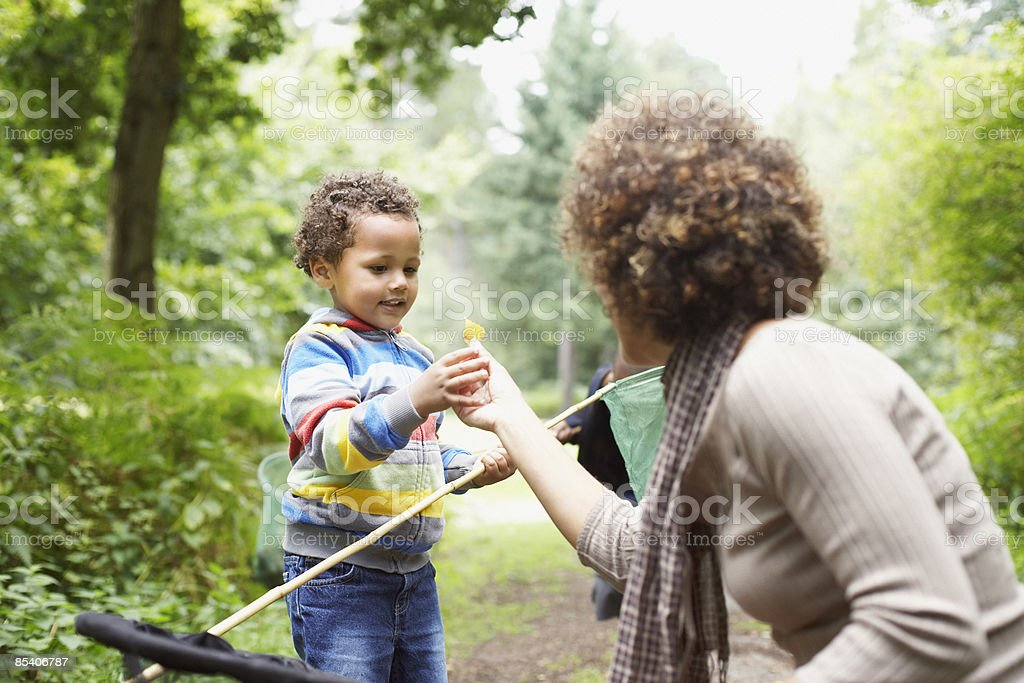 Mother and son exploring park royalty-free stock photo