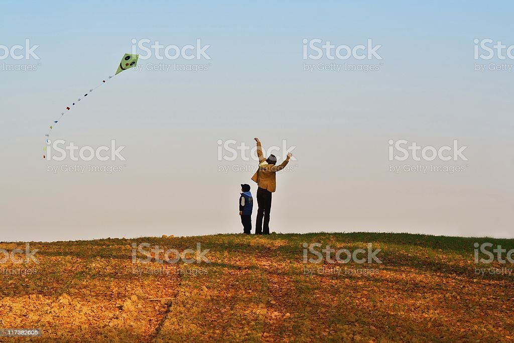 Mother and son fly a kite. royalty-free stock photo