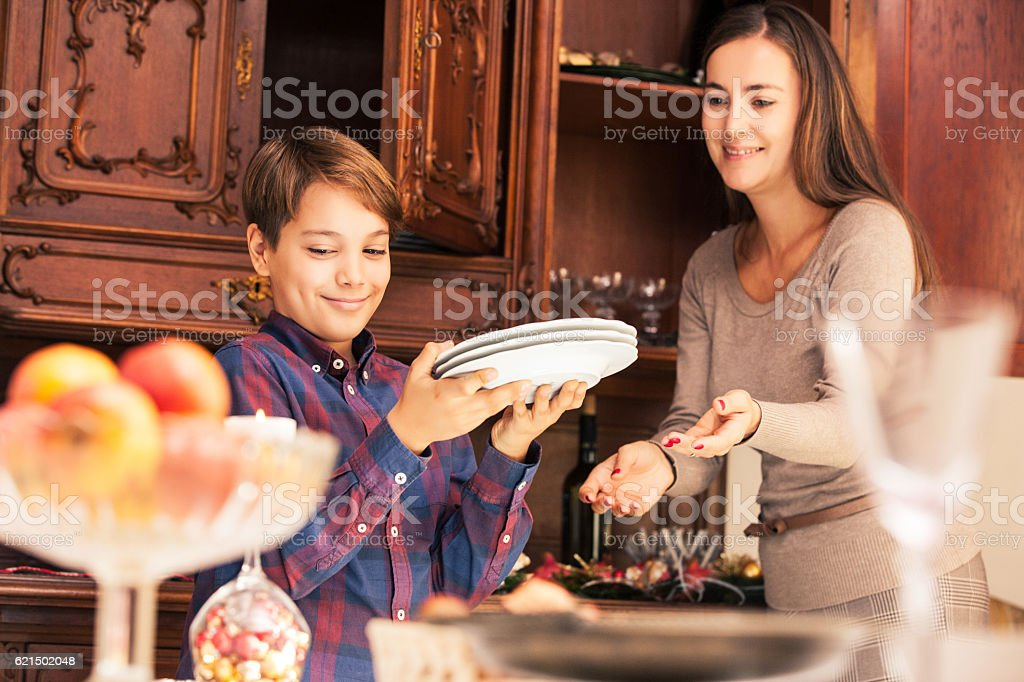Mother and Son getting the Table ready on Christmas Eve foto stock royalty-free
