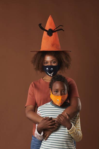 mother and son halloween studio shot - halloween covid fotografías e imágenes de stock