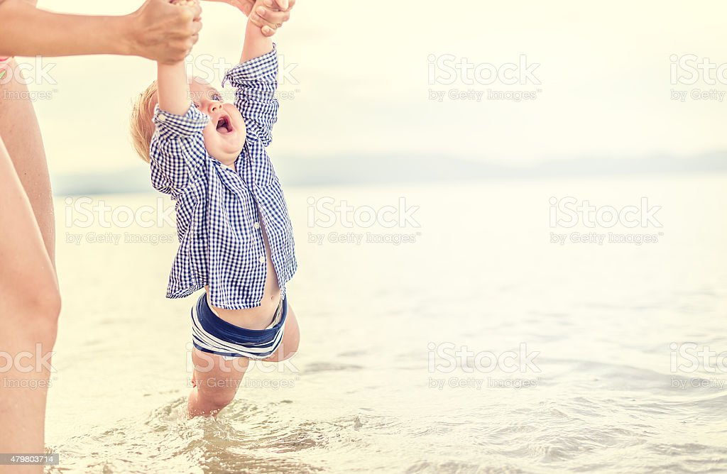 Mother and son have a fun in the sea stock photo