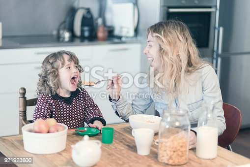 istock Mother and son having breakfast in the kitchen at home 921923600