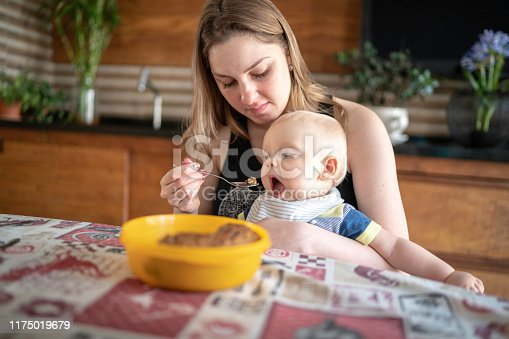 Mother and son having breakfast together