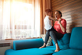 istock Mother and son having fun at home 1215765574