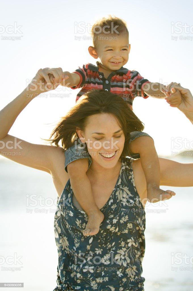 Mother and son having fun in the sun stock photo