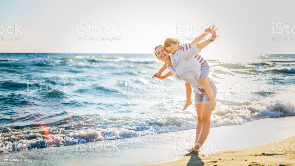 Mother and son having fun on the beach royalty-free stock photo