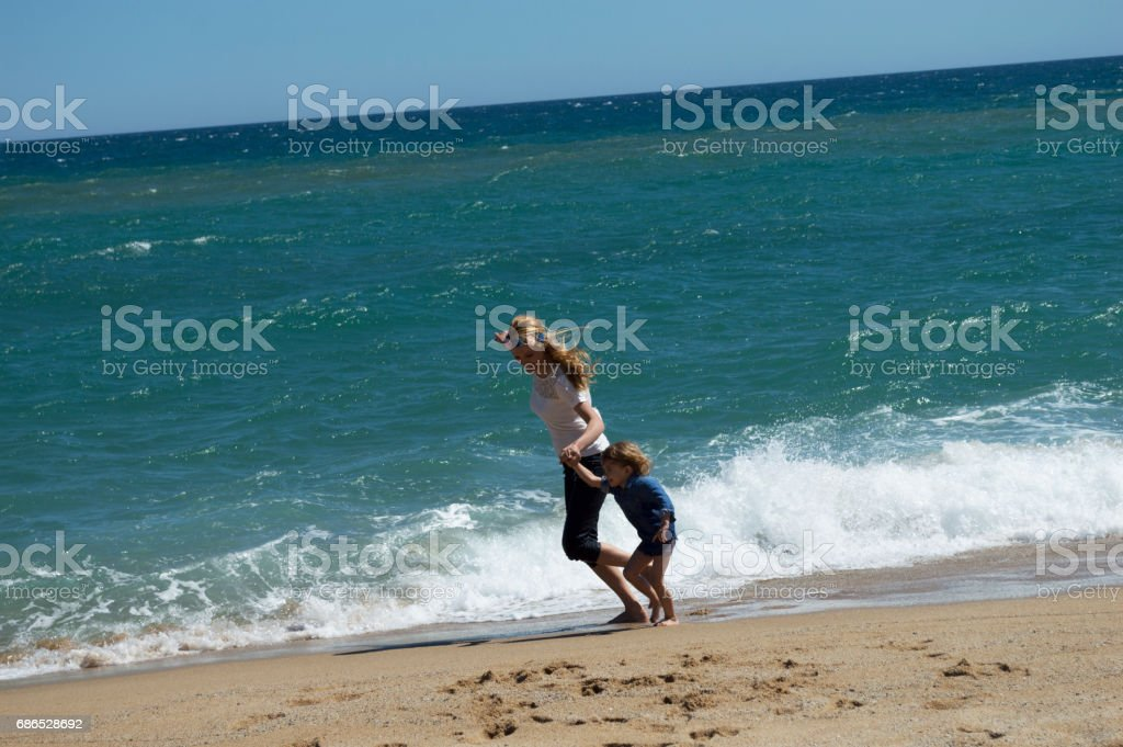 Mother and son having fun on the beach foto stock royalty-free